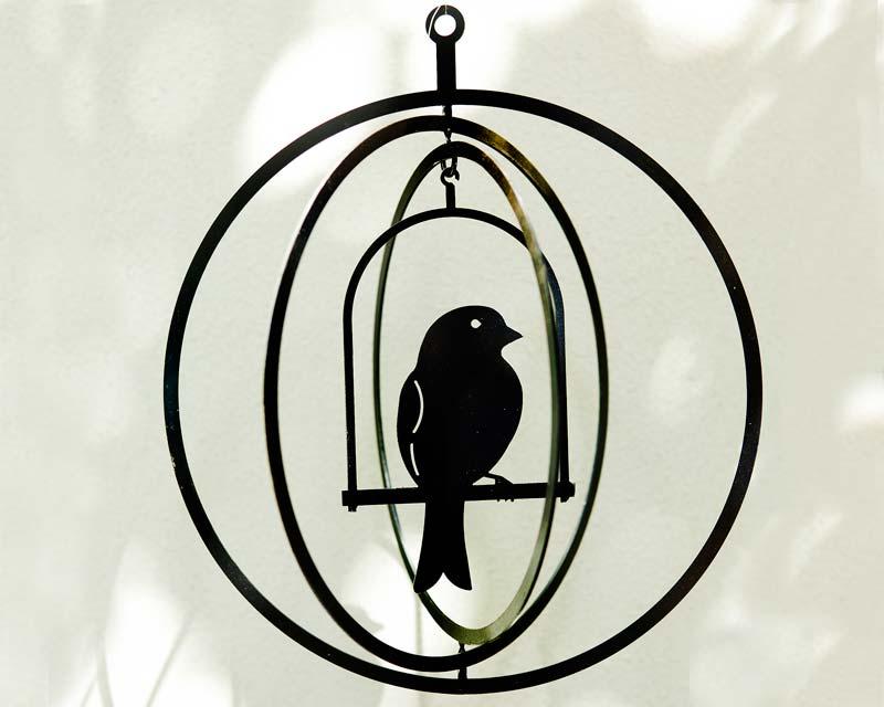Suspended art - bird in a circular cage