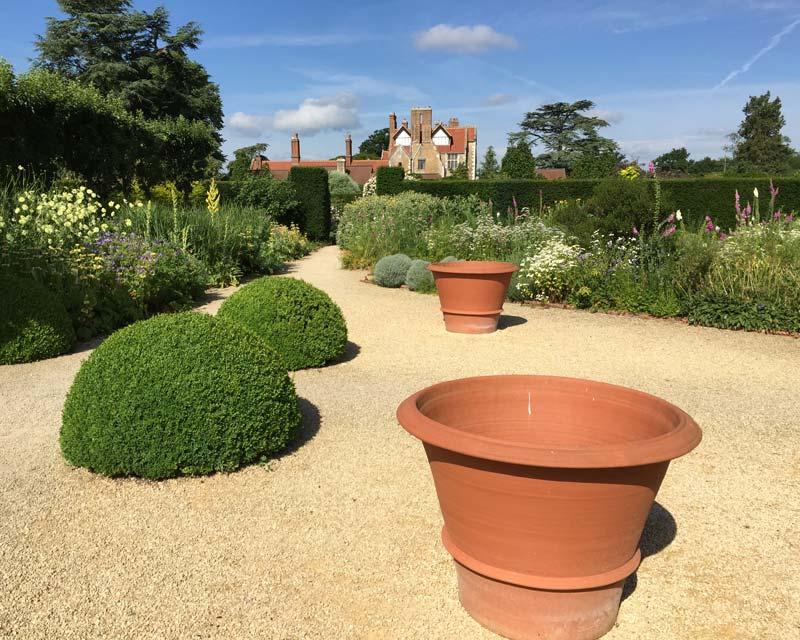 Loseley Park- gravel paths lead through the Herb Garden to the Rose Garden