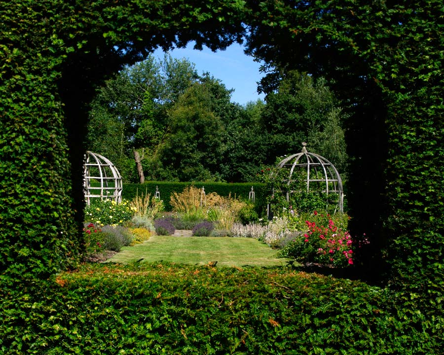 The Rose Garden viewed through windows in the Yew Hedge