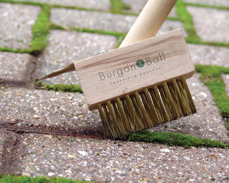 Compact Miracle Block Paving Brush designed to remove moss and weeds