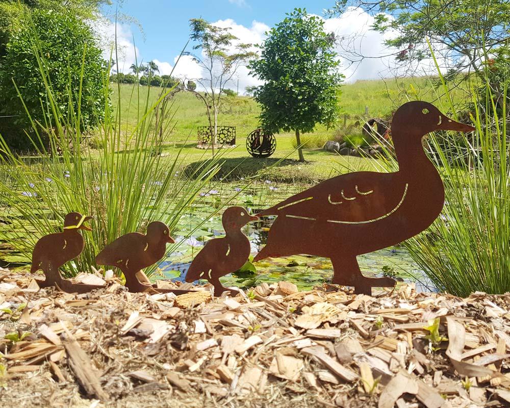 Duck and ducklings - decorative garden art