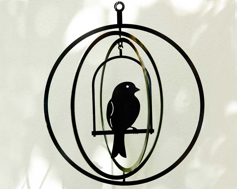 Suspended art - bird in a circular cage