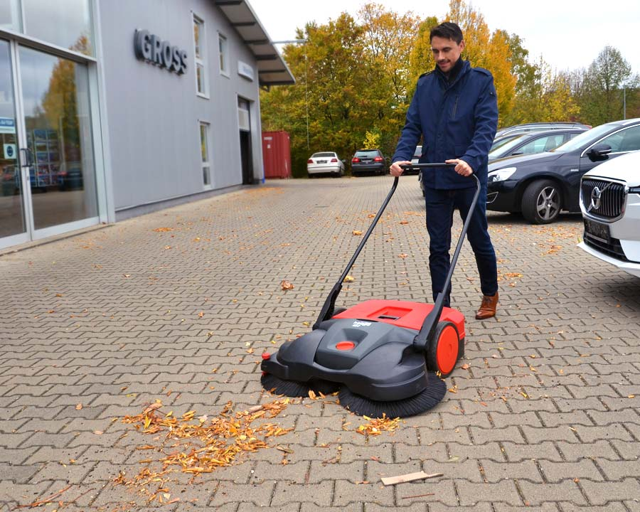 The Haaga 497 outdoor sweeper in use