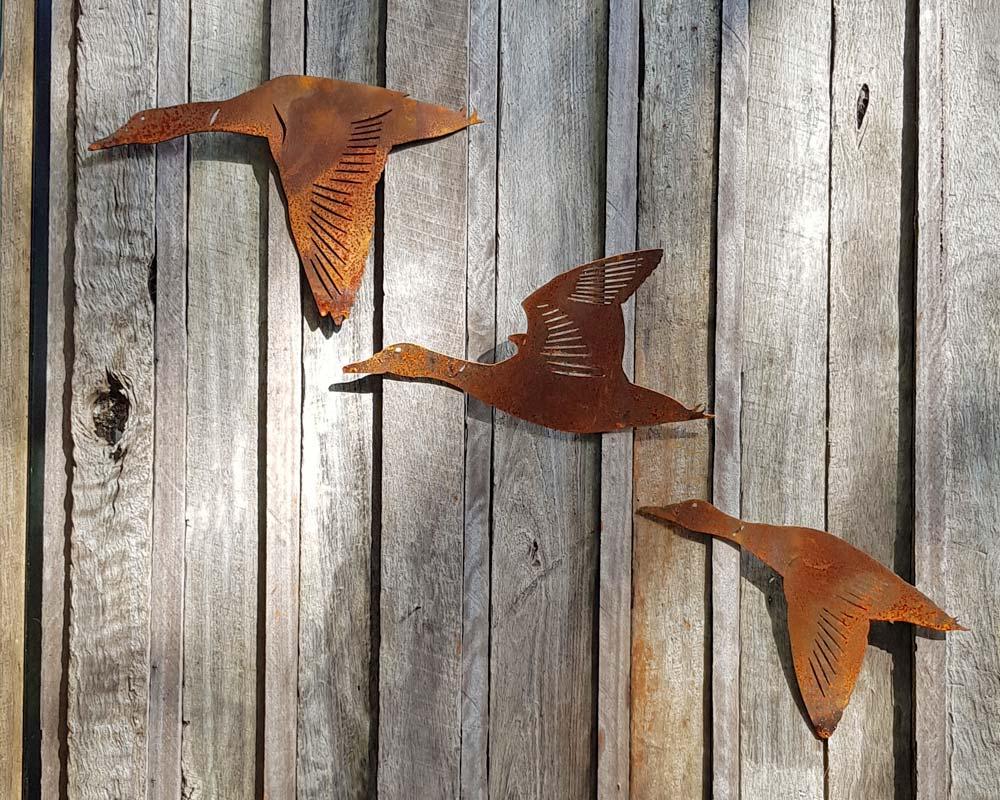 Flying ducks - decorative garden art
